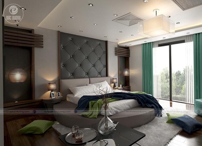 Một thiết kế đầu giường bọc đệm với hình tròn độc đáo